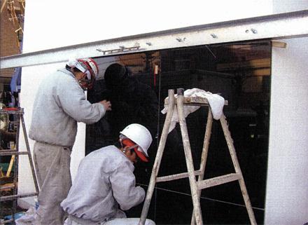 石 タイル工事 サブエントランス外壁黒御影石施工状況