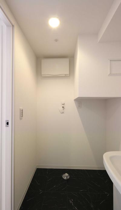 工事中に設計者が撮影した入居募集写真洗濯機スペース|一日でも早く満室にするための新築賃貸マンション入居者募集方法